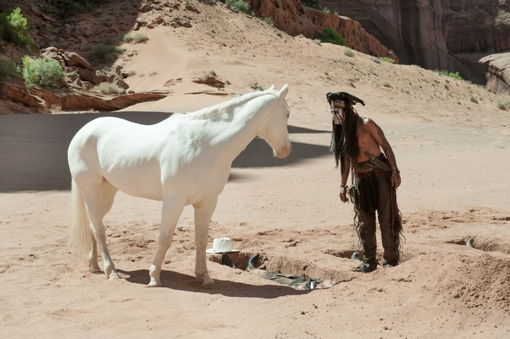 The four main characters of the movie: Tonto, Silver, the not-spiritually dead crow and the Lone Ranger as he is about to be raised from the dead.