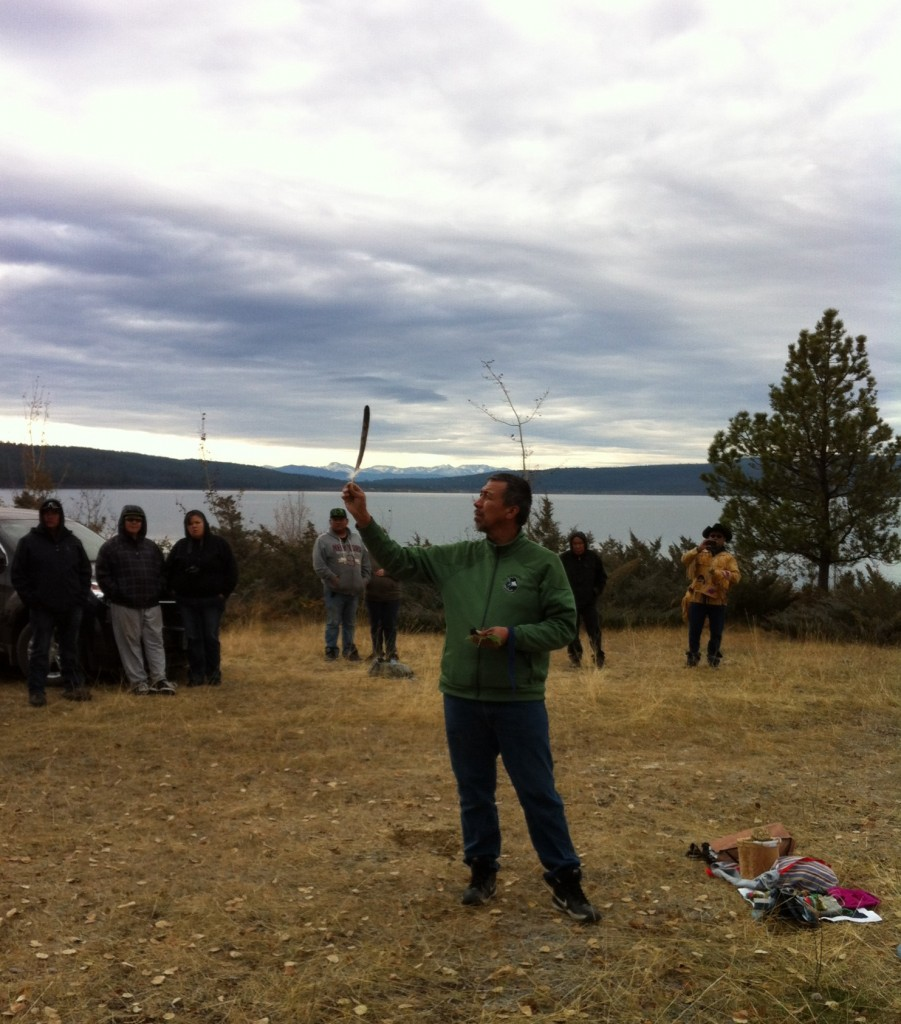 Tsilhqot'in spiritual leader Cecil Grinder holds up the feather for the crowd to see.