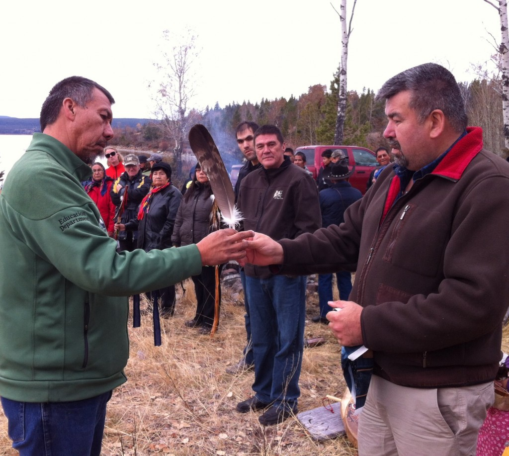 On behalf of Chief Byron Louis of the Okanagan First Nation, Cecil Grinder presents the feather to Joe Alphonse chairman of the Tsilhqot'in National Government.